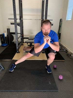 One leg of the lateral squat