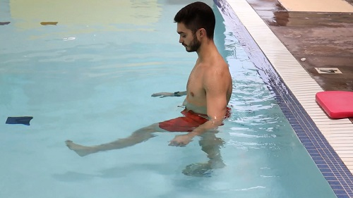 A demonstration of aquatic hip flexion leg raise