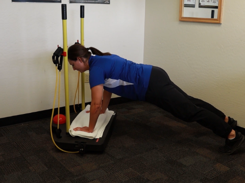 Top position of a pushup using the balance board.