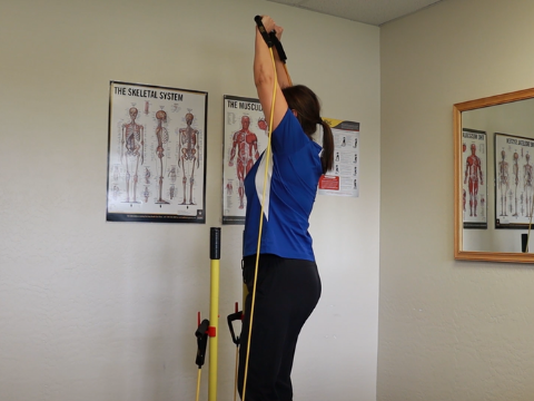 Final position for the standing overhead press.