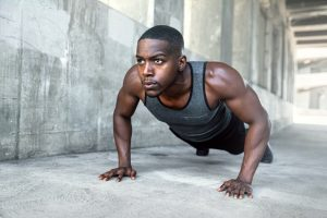 A man doing pushups in an upper body micro workout.