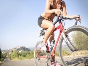 A woman performing cardio exercise on her bike.