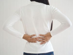 A woman with back pain from piriformis syndrome.