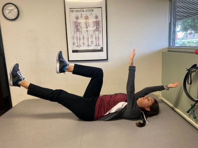 The ending position for the dead bug exercise.