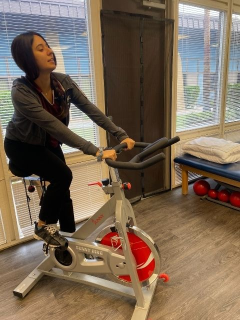 A PT technician on the exercise bike.